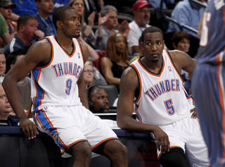 Oklahoma City's Serge Ibaka (9) and Kendrick Perkins (5) wait to check in during an NBA basketball game between the Oklahoma City Thunder and the Charlotte Bobcats at the Oklahoma City Arena, Friday, March 18, 2011. Photo by Bryan Terry, The Oklahoman