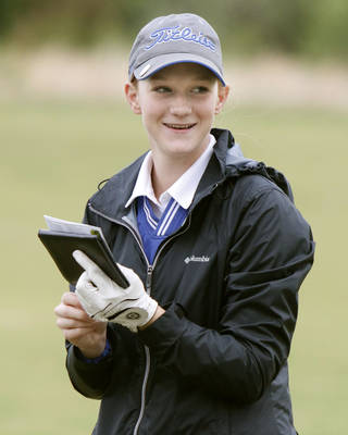 """Turner's Tracy McGill is all grins as she writes a """"1"""" on her scorecard during the Class 2A Girls Golf State Tournament at the Trosper Park Golf Course in Midwest City, OK, Thursday, May 8, 2014. She hit a hole-in-one on the 170 yard 2nd hole. Photo by Paul Hellstern, The Oklahoman"""