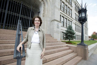 Oklahoma City University Dean of Law School Valerie Couch stands in front of Central High School. Steve Gooch - The Oklahoman