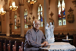 As young boy attending Catholic grade school, Joe Ross was an altar boy at the team Mass for Notre Dame players at the local Catholic parish in Chickasha the day before the Irish ended OU's winning streak in 1957. Now, he's Father Ross, pastor of Blessed Sacrament Parish in Lawton. Having later attended Notre Dame, that day with the Irish in 1957 is one that lives on for this Oklahoma priest.. He met with a reporter and posed for photos in St. Joseph's Old Cathedral in downtown Oklahoma City on Monday, Oct. 22, 2012. Photo by Jim Beckel, The Oklahoman