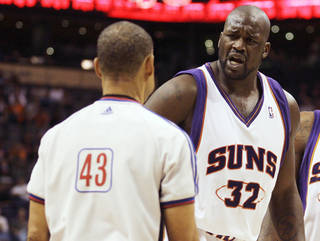 Phoenix Suns center Shaquille O'Neal, right, complains after he was called for a technical foul by referee Dan Crawford, left, in the third quarter of an NBA basketball game against the Portland Trail Blazers on Saturday, Nov. 22, 2008, in Phoenix. (AP Photo/Paul Connors) ORG XMIT: PNU108
