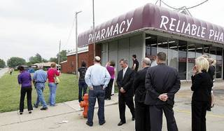 Jurors for the Jerome Ersland murder trial visit Reliable Pharmacy 5900 S Penn, Monday, May 23, 2011 where the robbery took place. The jurors observe the area north of the pharmacy. Photo by Doug Hoke, The Oklahoman. ORG XMIT: KOD