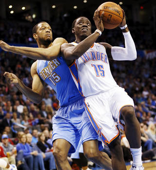 Oklahoma City's Reggie Jackson (15) drives to the basketball against Denver's Anthony Randolph (15) during an NBA basketball game between the Oklahoma City Thunder and the Denver Nuggets at the Chesapeake Energy Arena in Oklahoma City, Monday, March 24, 2014. Photo by Nate Billings, The Oklahoman