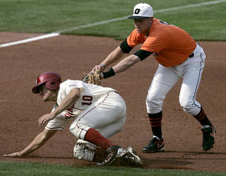 BEDLAM / OU / OSU / UNIVERSITY OF OKLAHOMA / OKLAHOMA STATE UNIVERSITY: Oklahoma State's Mark Ginther tags out Oklahoma's Ricky Eisenberg as he tries to get to third base during their college baseball game at RedHawks Field in Bricktown on Sunday, April 17, 2011. Photo by John Clanton, The Oklahoman ORG XMIT: KOD