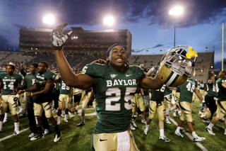 Baylor running back Lache Seastrunk (25) celebrates their 41-14 win over Kansas following an NCAA college football game on Saturday, Nov. 3, 2012, in Waco, Texas. (AP Photo/Waco Tribune Herald, Jerry Larson) ORG XMIT: TXWAC110