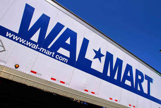 FILE - In this May 16, 2011 file photo, the Wal-Mart logo is displayed, (AP Photo/Seth Perlman, File)