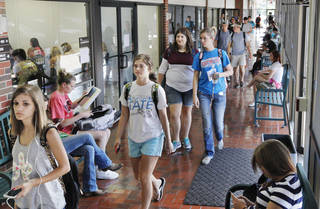 Students fill the hallway Aug. 18 while changing classrooms at Northern Oklahoma College's campus in Stillwater . Photos by Paul B. Southerland, The Oklahoman PAUL B. SOUTHERLAND - PAUL B. SOUTHERLAND