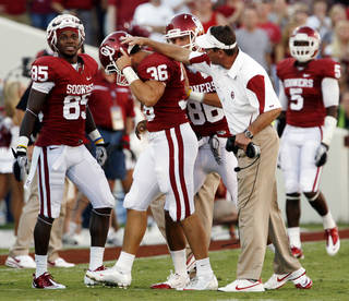 Head coach Bob Stoops congratulates punter Tress Way on an 85-yard punt during the first half of the college football game between the University of Oklahoma Sooners (OU) and Utah State University Aggies (USU) at the Gaylord Family-Oklahoma Memorial Stadium on Saturday, Sept. 4, 2010, in Norman, Okla. Photo by Steve Sisney, The Oklahoman