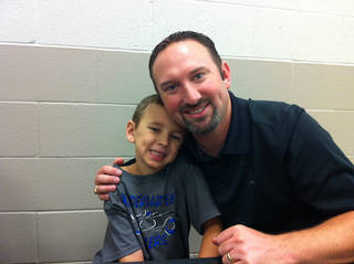 Jeremy Freeman, right, with his son Trey. PHOTO PROVIDED
