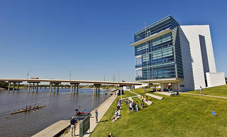 Spectators gather to watch the action at Chesapeake finish line tower and the Devon Boathouse during the Oklahoma Regatta Festival at the Oklahoma River on Saturday, Oct. 1, 2011, in Oklahoma City, Okla. Photo by Chris Landsberger, The Oklahoman
