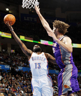 Oklahoma City's James Harden (13) takes a shot as Robin Lopez (15) of Phoenix defends during the NBA basketball game between the Oklahoma City Thunder and Phoenix Suns at Chesapeake Energy Arena in Oklahoma City, Saturday, Dec. 31, 2011. Photo by Nate Billings, The Oklahoman