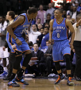 CELEBRATION: Oklahoma City Thunder's Kevin Durant, left, and Russell Westbrook, right, celebrate following a three-point basket by Westbrook late in the second half of an NBA basketball game against the Dallas Mavericks Wednesday, Feb. 1, 2012, in Dallas. Westbrook had a game-high 33-points in the 95-86 Thunder win. (AP Photo/Tony Gutierrez) ORG XMIT: DNA109