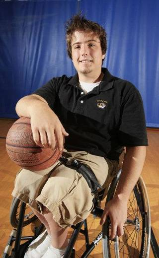 Wheelchair basketball athlete Colin Cutter, 18, Piedmont, poses for a photographer in the gym at the YMCA in Bethany Friday, July 23, 2010. Photo by Paul B. Southerland, The Oklahoman ORG XMIT: KOD