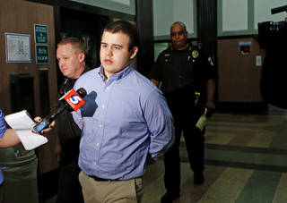 Tristan Owen, 17, leaves the courtroom Friday after being found guilty of two counts of manslaughter and one count of arson in an Oklahoma City. Photo by Bryan Terry, The Oklahoman