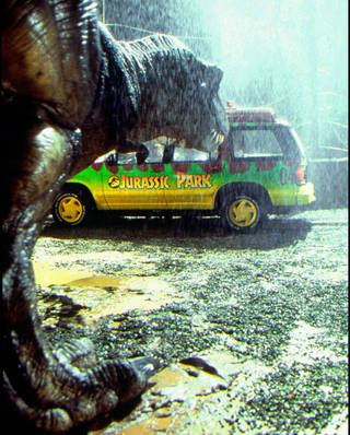 "A Tyrannosaurus rex descends on a vehicle in a scene from ""Jurassic Park 3D."" UNIVERSAL PICTURES PHOTO MURRAY CLOSE"