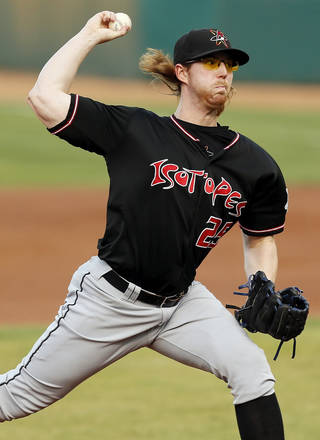 Red Patterson (25) pitches for Albuquerque during a minor league baseball game between the Albuquerque Isotopes and the Oklahoma City RedHawks at Chickasaw Bricktown Ballpark in Oklahoma City, Friday, Aug. 16, 2013. Photo by Nate Billings, The Oklahoman