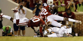 Quentin Hayes (10) and Cortez Johnson (22) knock the ball from runner Kevin White (11) allowing Gabe Lynn (9) to pick up the fumble during the second half of a college football game between the University of Oklahoma Sooners (OU) and the West Virginia University Mountaineers at Gaylord Family-Oklahoma Memorial Stadium in Norman, Okla., on Saturday, Sept. 7, 2013. Photo by Steve Sisney, The Oklahoman