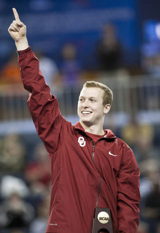 Oklahoma's Alec Robin celebrates after he won the floor exercise individuals event at the NCAA men's gymnastics championships in Ann Arbor, Mich., Saturday, April 12, 2014. (AP Photo/Tony Ding)