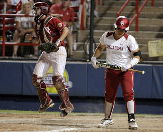 Oklahoma's Georgia Casey (42) walks away after striking out as Alabama's Kendall Dawson (12) celebrates in the sixth inning during the championship game of the Women's College World Series as ASA Stadium in Oklahoma City, Tuesday, June 5, 2012. Photo by Bryan Terry, The Oklahoman