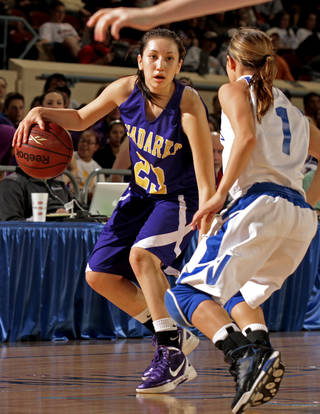 CLASS 4A HIGH SCHOOL BASKETBALL / STATE TOURNAMENT: Anadarko Lady Warrior Lakota Beatty (23) plays guarded by Vinita Lady Hornets' Terri Markham (1) in the Oklahoma State Class 4A Girls Basketball Tournament at the Fairgrounds Arena on Friday, March 9, 2012, in Oklahoma City, Okla. Photo by Steve Sisney, The Oklahoman