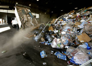 Norman sanitation crews dump a load of trash Tuesday at the city's transfer station. PHOTO BY STEVE SISNEY, THE OKLAHOMAN STEVE SISNEY