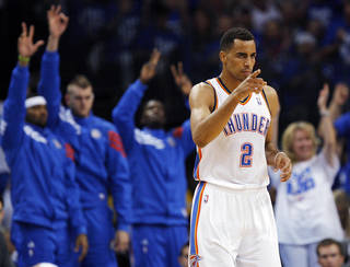 Oklahoma City's Thabo Sefolosha (2) reacts after a 3-point shot during Game 4 of the Western Conference Finals between the Oklahoma City Thunder and the San Antonio Spurs in the NBA playoffs at the Chesapeake Energy Arena in Oklahoma City, Saturday, June 2, 2012. Photo by Nate Billings, The Oklahoman