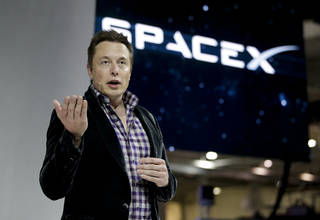 Elon Musk, CEO and CTO of SpaceX, introduces the SpaceX Dragon V2 spaceship Thursday at the SpaceX headquarters in Hawthorne, Calif. AP Photo Jae C. Hong - AP