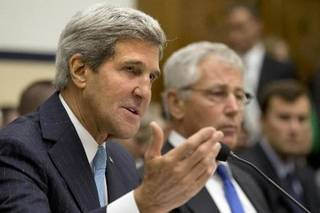 Secretary of State John Kerry, left, with Defense Secretary Chuck Hagel, testifies on Capitol Hill in Washington, Tuesday, Sept. 10, 2013, before the House Armed Services Committee hearing on the proposed authorization to use military force in Syria. (AP Photo/Jacquelyn Martin)