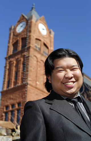 Malaysian UCO student Joshua Lim poses for a photo in front of Old North on the campus of the University of Central Oklahoma in Edmond, Okla., Monday, Nov. 12, 2012. Photo by Nate Billings, The Oklahoman