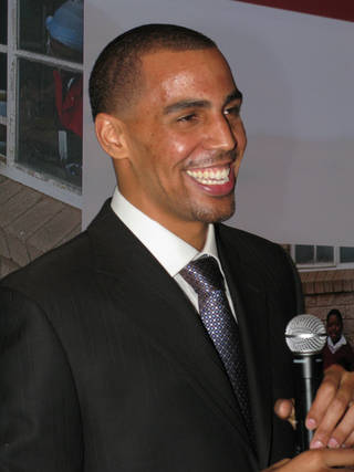 "Thabo Sefolosha jokes with guests at ""A Night for Africa"" party as he talks about building a youth sports program in the South African township of Mamelodi, his father's hometown. Photo by Lillie-Beth Brinkman, The Oklahoman."