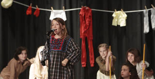 "Emma Mowry sings a song from ""Annie"" during the fifth-grade musical at Chisholm Elementary."