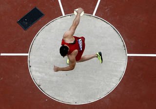 United States' Lance Brooks competes in the men's discus qualification Monday during the 2012 Summer Olympics at Olympic Stadium in London.