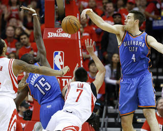 Oklahoma City's Reggie Jackson (15) and Nick Collison (4) defend Houston's Jeremy Lin (7) during Game 6 in the first round of the NBA playoffs between the Oklahoma City Thunder and the Houston Rockets at the Toyota Center in Houston, Texas, Friday, May 3, 2013. Photo by Bryan Terry, The Oklahoman