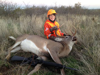 Hunter Kysela poses with the 14-point, 200-pound buck he shot in Blaine County during the youth deer season. Photo provided