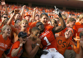 CROWD / CELEBRATION / FANS: OSU's Dez Bryant (1) celebrates the Cowboys' victory over Bulldogs following the college football game between OSU and the University of Georgia at Boone Pickens Stadium on the campus of Oklahoma State University in Stillwater Saturday, Sept. 5, 2009. Photo by Sarah Phipps, The Oklahoman. ORG XMIT: KOD