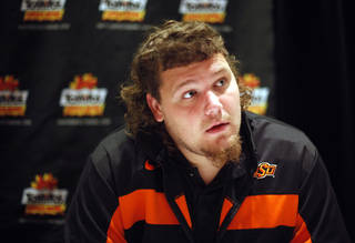 Oklahoma State's Levy Adcock talks to the media during an Oklahoma State press conference for the Fiesta Bowl at the Camelback Inn in Paradise Valley, Ariz., Thursday, Dec. 29, 2011. Photo by Sarah Phipps, The Oklahoman