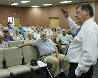 U.S. Rep. Tom Cole, right, R-Oklahoma, speaks during a town hall meeting in Duncan, Okla, Wednesday, Aug. 28, 2013. (AP Photo/Sue Ogrocki) ORG XMIT: OKSO103