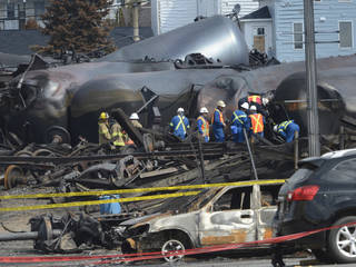 Emergency workers examine the aftermath of a train derailment and fire July 6 in Lac-Megantic, Quebec. AP File Photo Ryan Remiorz - AP