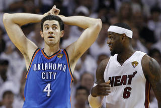 Oklahoma City Thunder power forward Nick Collison (4) and Miami Heat small forward LeBron James (6) react during the second half at Game 3 of the NBA Finals basketball series, Sunday, June 17, 2012, in Miami. (AP Photo/Lynne Sladky)