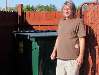 Ralph Smith, a maintenance worker at the Legacy Inn & Suites, stands in front of the trash bin Tuesday where he found discarded bomb-making materials in Miami, OK. Smith reported the find to authorities last week, and they later arrested Gregory Arthur Weiler II for possession of an explosive device. AP Photo Justin Juozapavicius