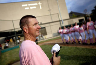 WEAR / WEARING PINK / GIRLS HIGH SCHOOL SOFTBALL: Volunteer coach Matt Allen stands on the field before a Bishop McGuinness softball game in Oklahoma City, Tuesday, Sept. 14, 2011. Allen was diagnosed with brain cancer two years ago and continues his volunteer coaching duties with the softball team. Win-Win Week is a statewide effort by Oklahoma high schools to support cancer awareness. Photo by Bryan Terry, The Oklahoman ORG XMIT: KOD