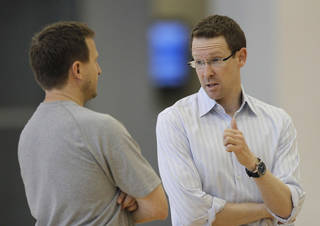 Scott Brooks, left, listens to general manager Sam Presti after the Thunder practice Sunday, June 10, 2012. Photo by Doug Hoke, The Oklahoman