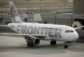 File photo - A Frontier Airlines Airbus 319 heads down the tarmac at Denver International Airport to a nearby runway for takeoff in Denver. (AP Photo/David Zalubowski, FILE)