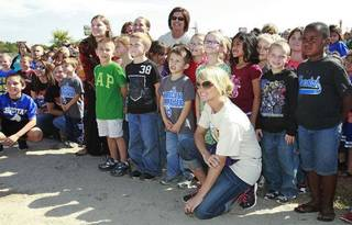Carrie Underwood poses for a photo with students and teachers after helping build a playground at her former school, Marshall Elementary School, in Checotah, Friday, October 14, 2011. Photo by David McDaniel, The Oklahoman ORG XMIT: KOD