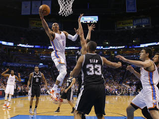 Oklahoma City's Russell Westbrook (0) goes to the basket during an NBA basketball game between the Oklahoma City Thunder and the San Antonio Spurs at Chesapeake Energy Arena in Oklahoma City, Thursday, April 3, 2014. Oklahoma City won 106-94. Photo by Bryan Terry, The Oklahoman