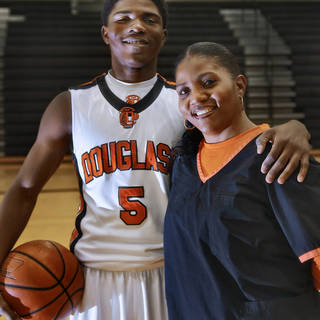 HIGH SCHOOL BASKETBALL / DORSHELL CLARK: Douglass High School junior Stephen Clark poses with a photo with his mother Dorshell at the high school gym on Wednesday, Feb. 8, 2012, in Oklahoma City, Okla. Photo by Chris Landsberger, The Oklahoman