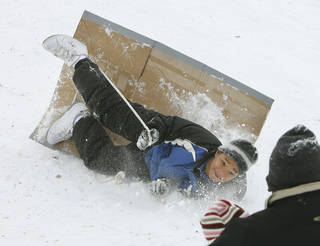 Ten year old Karon Willis tumbles from his sled at Will Rogers Park in Oklahoma City, OK, Saturday, Jan. 30, 2010. By Paul Hellstern, The Oklahoman