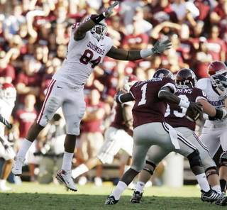 OU's Frank Alexander leaps toward Texas A&M's Jerrod Johnson during the college football game between the University of Oklahoma and Texas A&M University at Kyle Field in College Station, Texas, Saturday, November 8, 2008. BY BRYAN TERRY, THE OKLAHOMAN