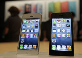 The new Apple iPhone 5 is displayed Sept. 12 after the introduction of new products in San Francisco. AP Photo Eric Risberg