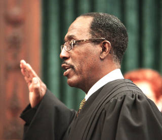 Tom Colbert takes the oath of office Friday as the first black chief justice of the Oklahoma Supreme Court. Photo by David McDaniel, The Oklahoman